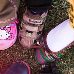 SHOE SWAP: Sarah loves teaching the children new songs and games.