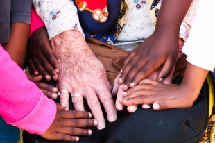 HEALING HANDS: Sarah encourages strong values of love and encouragement at the school where she is a guest teacher.